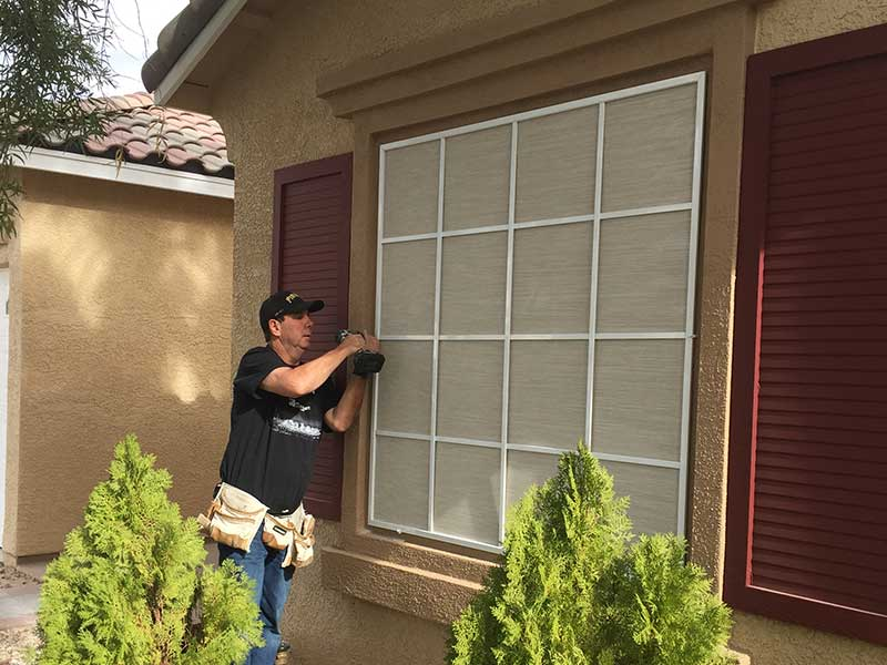 Jim Barilla installs a solar screen